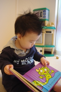 Jake with his fav book 'That's not my monster!'